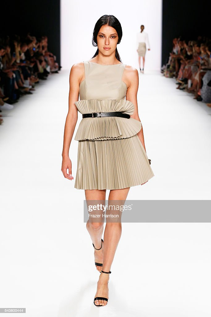 Rebecca Mir walks the runway at the Dimitri show during the Mercedes-Benz Fashion Week Berlin Spring/Summer 2017 at Erika Hess Eisstadion on June 30, 2016 in Berlin, Germany.