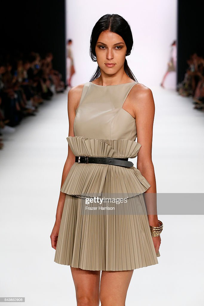 <a gi-track='captionPersonalityLinkClicked' href=/galleries/search?phrase=Rebecca+Mir&family=editorial&specificpeople=7831846 ng-click='$event.stopPropagation()'>Rebecca Mir</a> walks the runway at the Dimitri show during the Mercedes-Benz Fashion Week Berlin Spring/Summer 2017 at Erika Hess Eisstadion on June 30, 2016 in Berlin, Germany.