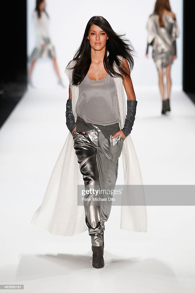 <a gi-track='captionPersonalityLinkClicked' href=/galleries/search?phrase=Rebecca+Mir&family=editorial&specificpeople=7831846 ng-click='$event.stopPropagation()'>Rebecca Mir</a> walks the runway at the Riani show during Mercedes-Benz Fashion Week Autumn/Winter 2014/15 at Brandenburg Gate on January 14, 2014 in Berlin, Germany.