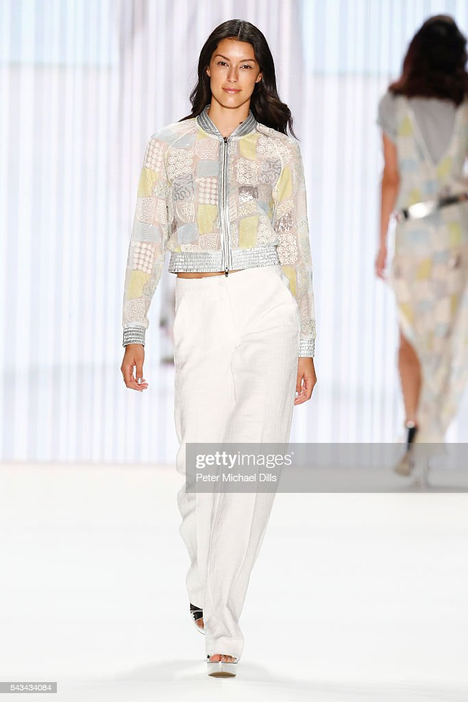 <a gi-track='captionPersonalityLinkClicked' href=/galleries/search?phrase=Rebecca+Mir&family=editorial&specificpeople=7831846 ng-click='$event.stopPropagation()'>Rebecca Mir</a> walks the runway at the Riani show during the Mercedes-Benz Fashion Week Berlin Spring/Summer 2017 at Erika Hess Eisstadion on June 28, 2016 in Berlin, Germany.