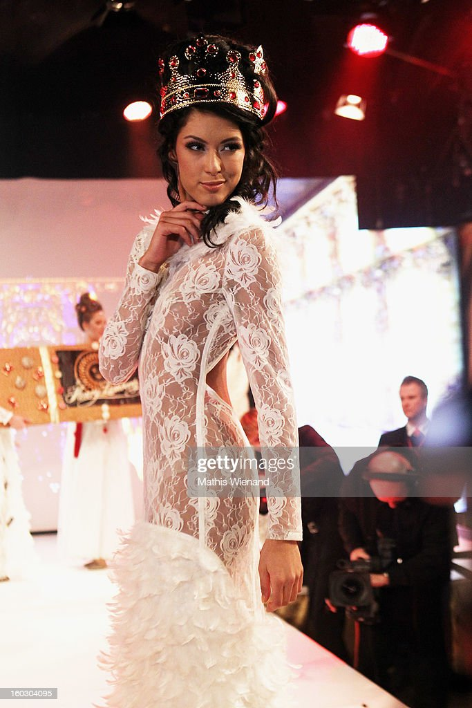 Rebecca Mir wearing creations out of Cake packagins by artist Larisa Katz Art couture walks the catwalk during the Lambertz Monday Night at Alter Wartesaal on January 28, 2013 in Cologne, Germany.
