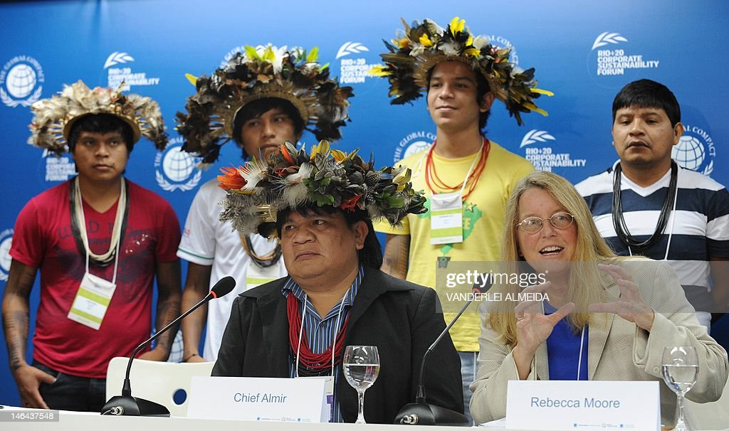Rebecca Moore (R-front), Engineering Manager of Google Earth Engine and Earth Outreach, speaks alongside Brazilian Surui tribe Chief Almir (L-front) and members, during press conference in Rio de Janeiro, Brazil on June 16, 2012. Moore announced the creation of a Google culture map for the Surui tribe in Amazonia. The UN conference, which marks the 20th anniversary of the Earth Summit -- a landmark 1992 gathering that opened the debate on the future of the planet and its resources -- is the largest ever organized, with 50,000 delegates.