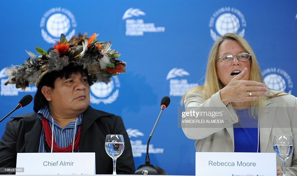 Rebecca Moore (R), Engineering Manager of Google Earth Engine and Earth Outreach, speaks alongside Brazilian Surui tribe Chief Almir (L), during press conference in Rio de Janeiro, Brazil on June 16, 2012. Moore announced the creation of a Google culture map for the Surui tribe in Amazonia. The UN conference, which marks the 20th anniversary of the Earth Summit -- a landmark 1992 gathering that opened the debate on the future of the planet and its resources -- is the largest ever organized, with 50,000 delegates.AFP PHOTO /VANDERLEI ALMEIDA