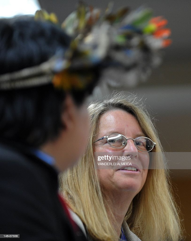 Rebecca Moore (R), Engineering Manager of Google Earth Engine and Earth Outreach, smiles alongside Brazilian Surui tribe Chief Almir (L), during press conference in Rio de Janeiro, Brazil on June 16, 2012. Moore announced the creation of a Google culture map for the Surui tribe in Amazonia. The UN conference, which marks the 20th anniversary of the Earth Summit -- a landmark 1992 gathering that opened the debate on the future of the planet and its resources -- is the largest ever organized, with 50,000 delegates.