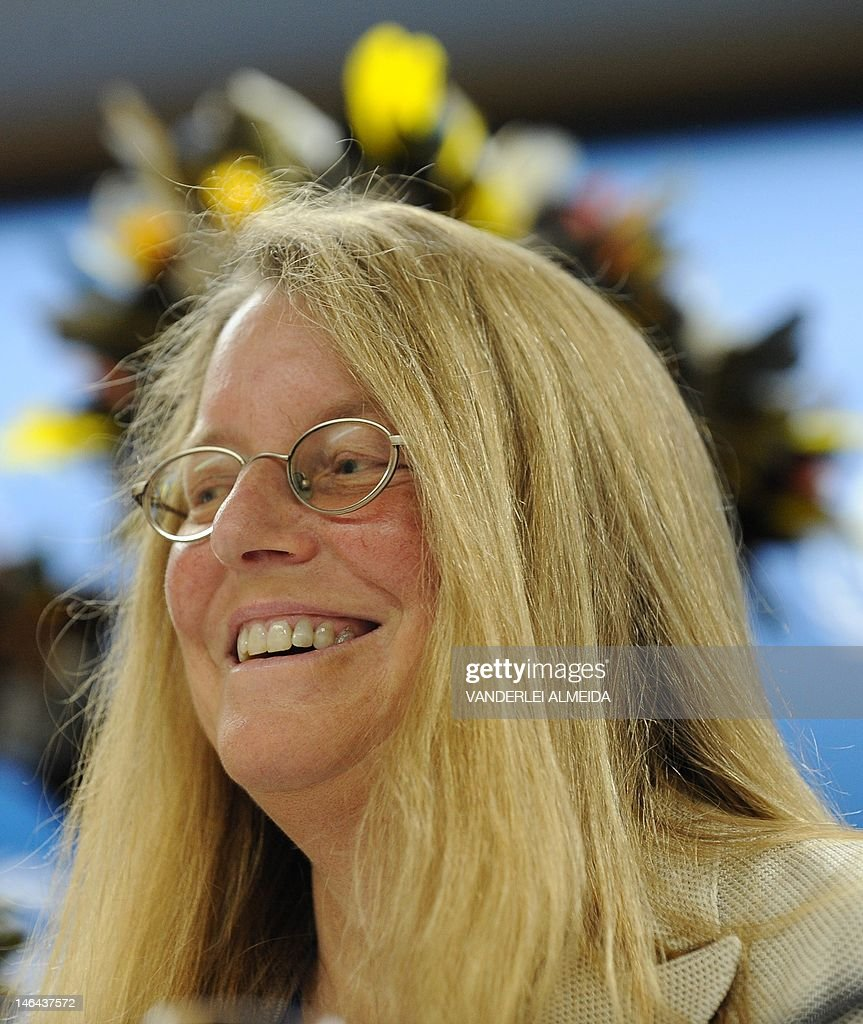 Rebecca Moore (R), Engineering Manager of Google Earth Engine and Earth Outreach, smiles alongside Brazilian Surui tribe Chief Almir (out of frame), during press conference in Rio de Janeiro, Brazil on June 16, 2012. Moore announced the creation of a Google culture map for the Surui tribe in Amazonia. The UN conference, which marks the 20th anniversary of the Earth Summit -- a landmark 1992 gathering that opened the debate on the future of the planet and its resources -- is the largest ever organized, with 50,000 delegates.