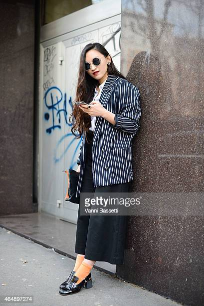 Rebecca Pan poses in a vintage outfit on March 1 2015 in Milan Italy