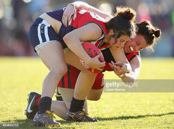 Rebecca Privitelli of Darebin is tackled by Lauren Morecroft of Diamond Creek during the Premier Division of the Victorian Women's Football League...