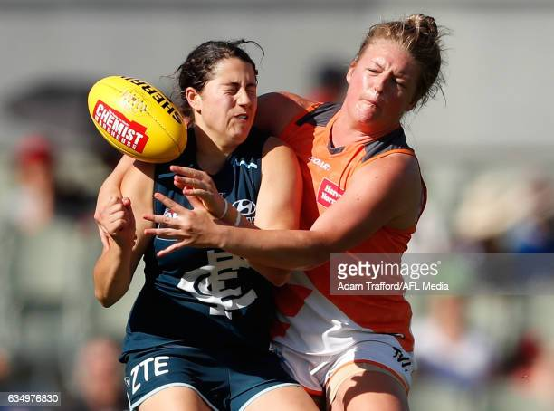 Rebecca Privitelli of the Blues is tackled by Hannah Wallett of the Giants during the 2017 AFLW Round 02 match between the Carlton Blues and the GWS...