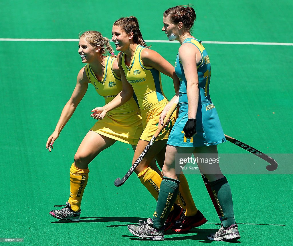 Rebecca Reuter and Jill Dwyer of the Hockeyroos celebrate a goal as Karri McMahon of the Jillaroos looks on in the gold medal match between the Australian Hockeyroos and the Australian Jillaroos during day four of the 2012 International Super Series at Perth Hockey Stadium on November 25, 2012 in Perth, Australia.