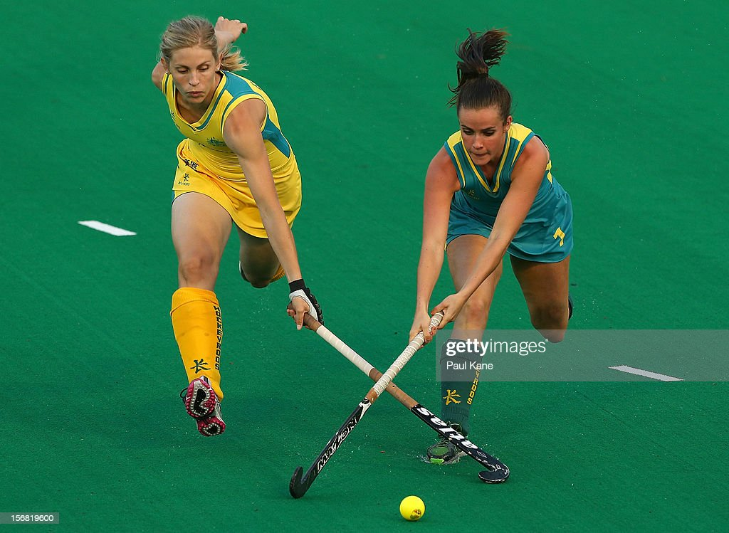 Rebecca Reuter of the Hockeyroos and Amelia Spence of the Jillaroos contest for the ball against during the womens Australia v Australia under 21 game on day one of the 2012 International Super Series at Perth Hockey Stadium on November 22, 2012 in Perth, Australia.