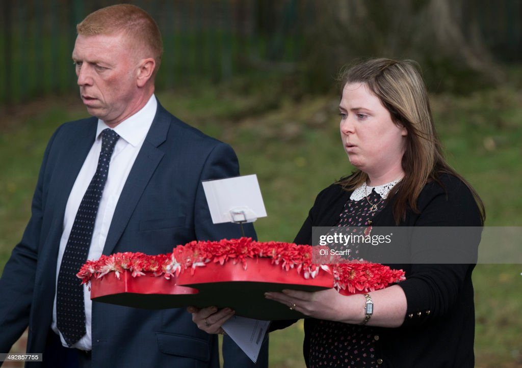 Rebecca Rigby the widow of murdered fusilier Lee Rigby lays a wreath at the scene of Mr Rigby's murder adjacent to the Royal Artillery Barracks on...