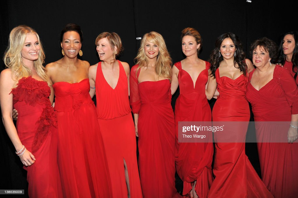 Rebecca Romijn Aisha Tyler Jennifer Nettles Christie Brinkley Elisabeth Rohm Gloria Estefan and Debbie Phelps pose backstage at The Heart Truth's Red...