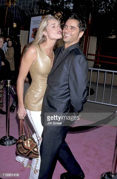 Rebecca Romijn and John Stamos during 'Austin Powers The Spy Who Shagged Me' Los Angeles Premiere at Universal Amphitheatre in Universal City...