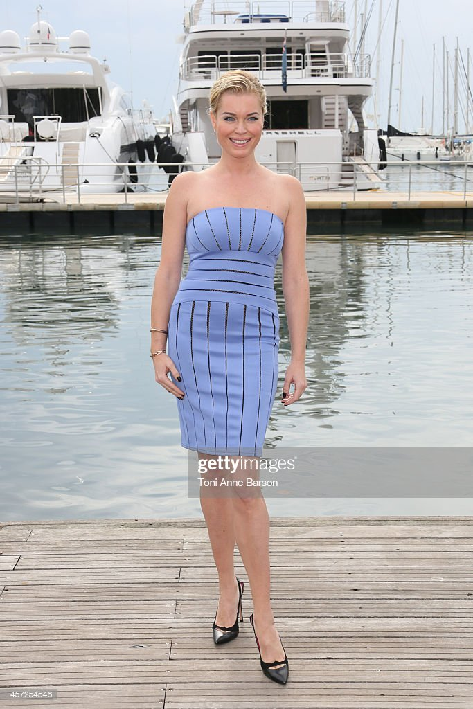 Rebecca Romijn poses during'The Librarians' photocall at Mipcom 2014 on October 13 2014 in Cannes France