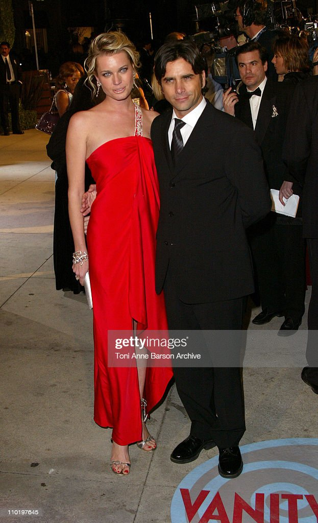 Rebecca RomijnStamos and John Stamos during 2004 Vanity Fair Oscar Party Arrivals at Mortons in Beverly Hills California United States