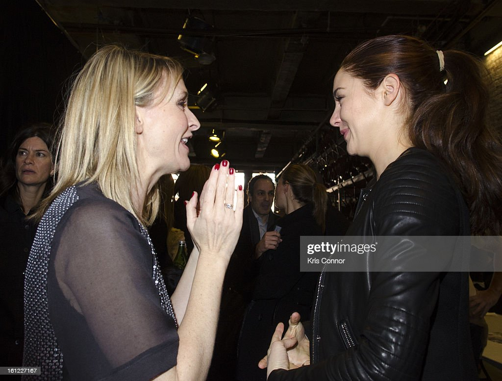 Rebecca Taylor and <a gi-track='captionPersonalityLinkClicked' href=/galleries/search?phrase=Shailene+Woodley&family=editorial&specificpeople=676833 ng-click='$event.stopPropagation()'>Shailene Woodley</a> speak backstage during the Rebecca Taylor Fall 2013 show during Mercedes-Benz Fashion Week at Highline Stages on February 9, 2013 in New York City.