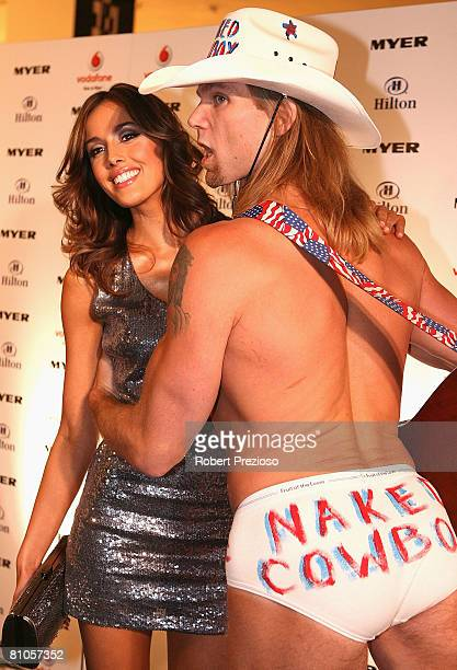 Rebecca Twigley poses with the Naked Cowboy during a launch party for Myer's '3 weeks in New York' at Studio 54 on May 12 2008 in Melbourne Australia