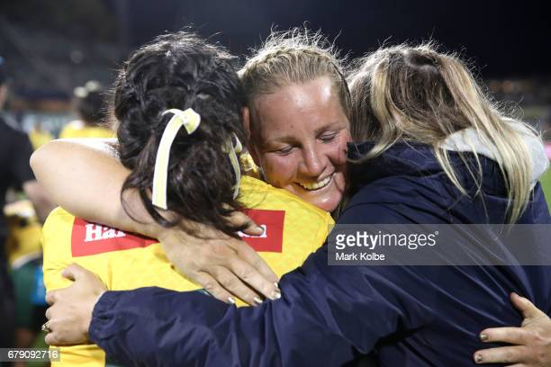 Rebecca Young of the Jillaroos celebrates victory with her team mates during the women's ANZAC Test match between the Australian Jillaroos and the...