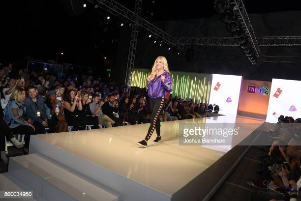 Rebecca Zamolo walks the runway at a celebration of the Forever 21 x Taco Bell Collection and the fans who inspired it at DTLA Fashion District on...