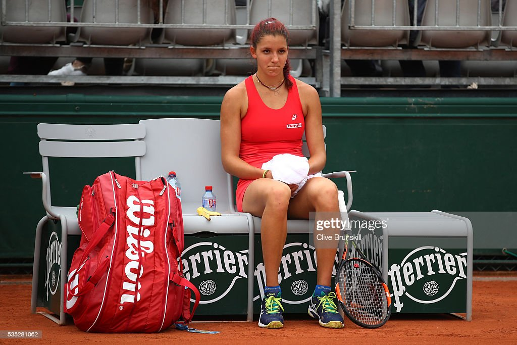 Rebeka Masarova of Switzerland looks on during the Girls Singles first round match against Wushuang Zheng of China on day eight of the 2016 French Open at Roland Garros on May 29, 2016 in Paris, France.