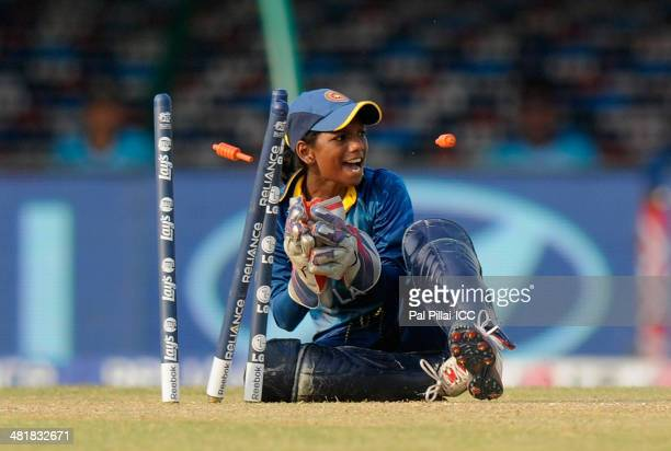 Rebeka Vandort of Sri Lanka appeals takes the bails off to get Shamima Sultana of Bangladesh run out during the ICC Women's World Twenty20 match...