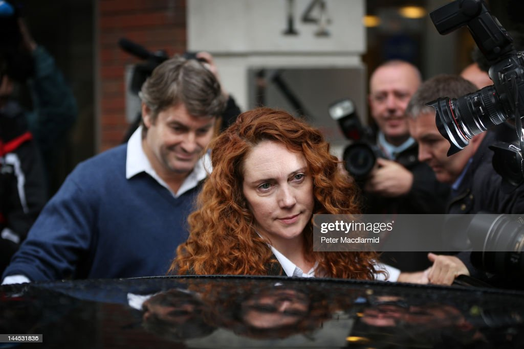 <a gi-track='captionPersonalityLinkClicked' href=/galleries/search?phrase=Rebekah+Brooks&family=editorial&specificpeople=6848116 ng-click='$event.stopPropagation()'>Rebekah Brooks</a> and her husband Charlie Brooks leave her solicitors office on May 15, 2012 in London, England. Mrs Brooks, former editor of the News of the World newspaper, and her husband Charlie Brooks, have been charged with conspiracy to pervert the course of justice in connection with the phone hacking inquiry.