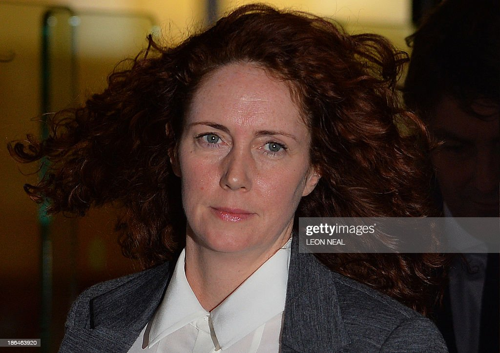 Rebekah Brooks, former News International chief executive, leaves the Old Bailey court in London on October 31, 2013 after another day's hearing in the phone hacking trial. Former News of the World editors Rebekah Brooks and Andy Coulson were having an affair throughout much of the time they were allegedly involved in phone hacking at the Rupert Murdoch-owned tabloid, their trial heard on October 31.