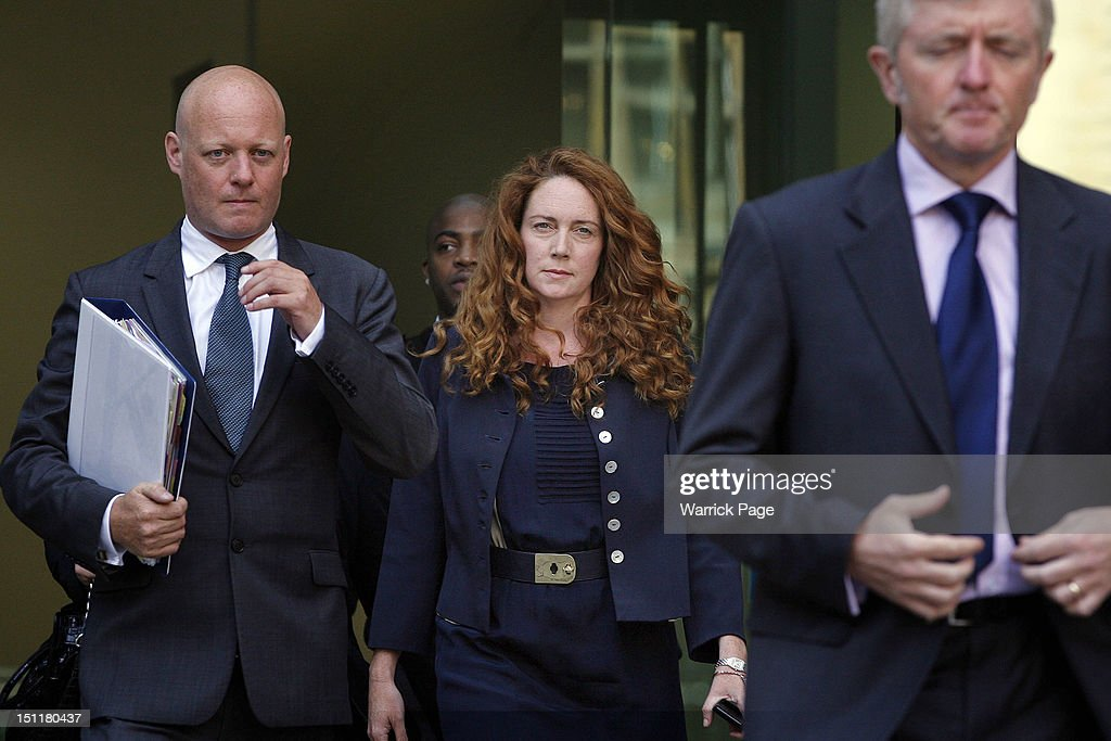 <a gi-track='captionPersonalityLinkClicked' href=/galleries/search?phrase=Rebekah+Brooks&family=editorial&specificpeople=6848116 ng-click='$event.stopPropagation()'>Rebekah Brooks</a> (C) leaves Westminster Magistrates Court after making an apperance this morning on September 3, 2012 in London, England. Mrs Brooks, the former News International Chief Executive, is appearing before magistrates in connection with the police investigation into phone hacking during her tenure at the News of the World newspaper.