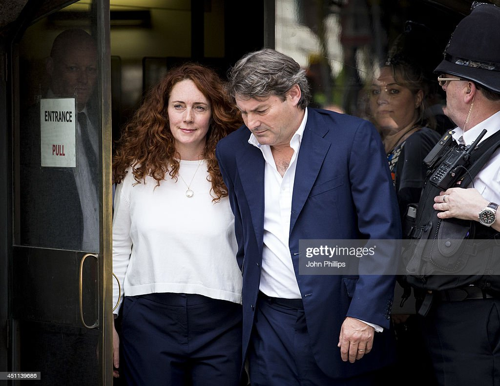 <a gi-track='captionPersonalityLinkClicked' href=/galleries/search?phrase=Rebekah+Brooks&family=editorial&specificpeople=6848116 ng-click='$event.stopPropagation()'>Rebekah Brooks</a> seen leaving the Old Bailey after being cleared of all charges on June 24, 2014 in London, England. Former government Director of Communications and News of The World editor Andy Coulson has been found guilty of conspiracy to hack phones after an eight month trial at the Old Bailey. <a gi-track='captionPersonalityLinkClicked' href=/galleries/search?phrase=Rebekah+Brooks&family=editorial&specificpeople=6848116 ng-click='$event.stopPropagation()'>Rebekah Brooks</a>, former editor and News International Chief Executive has been found not guilty of all charges against her. The charges of phone hacking were brought by numerous celebrities and members of the public against the media company and forced the closure of the News of the World newspaper.