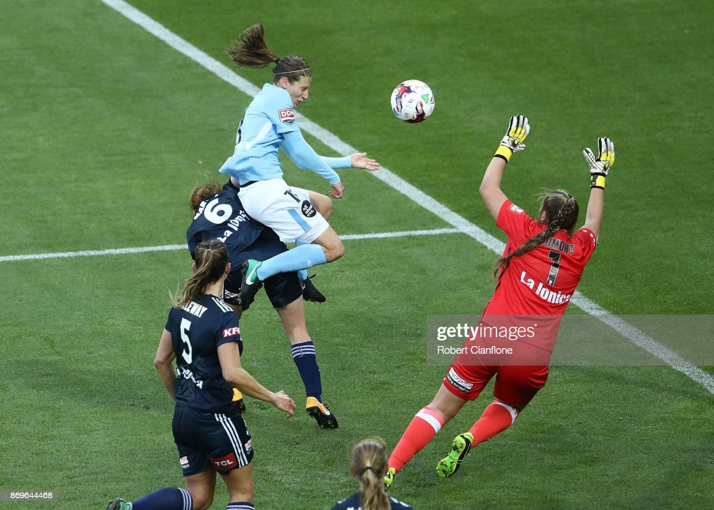Rebekah Stott of Melbourne City heads the ball past Victory goalkeeper Casey Dumont to score during the round two W-League match between Melbourne City FC and Melbourne Victory at AAMI Park on November 3, 2017 in Melbourne, Australia.
