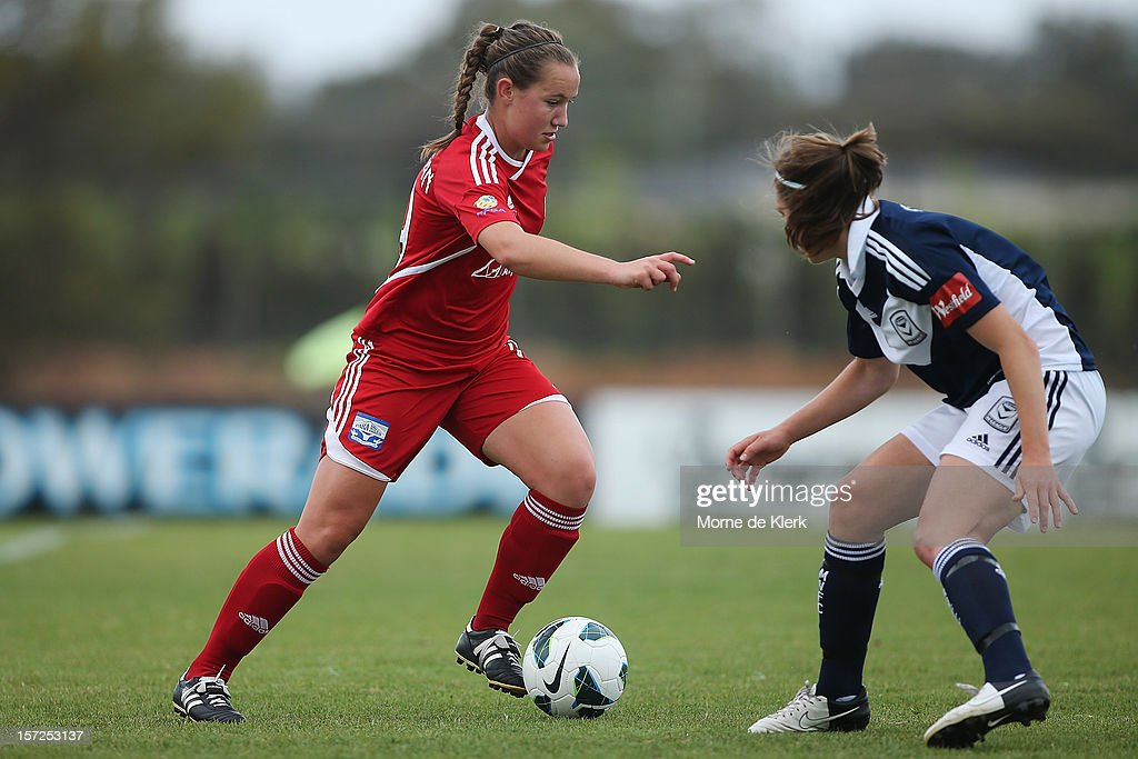 Rebekah Stott (R) of Melbourne competes wih Holly Patterson (L) of Adelaide during the round seven W-League match between Adelaide United and the Melbourne Victory at Burton Park on December 1, 2012 in Adelaide, Australia.