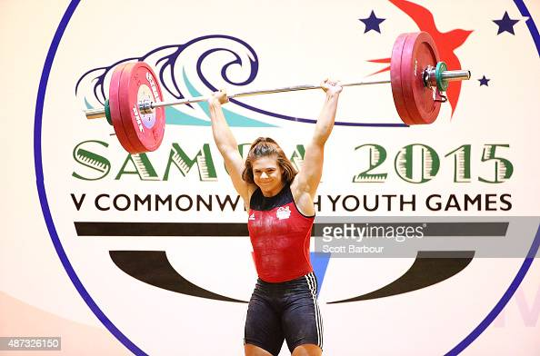Rebekah Tiler of England competes in the Women 63kg 69kg Weightlifting at the Tuanaimato Sports Facility on day three of the Samoa 2015 Commonwealth...