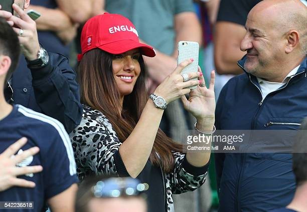 Rebekah Vardy wife of Jamie Vardy of England takes a photo on her phone during the UEFA EURO 2016 Group B match between Slovakia v England at Stade...