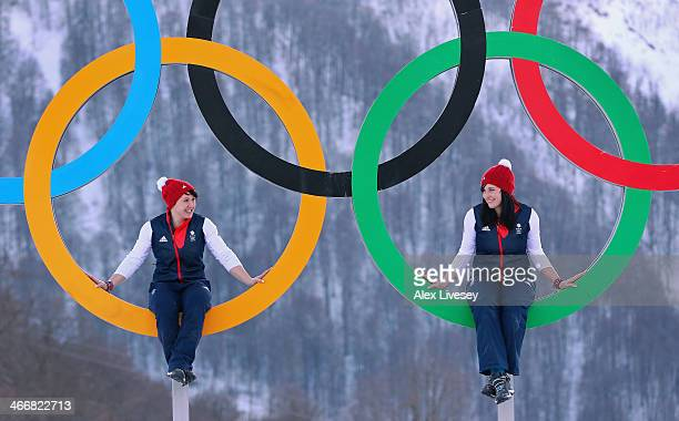Rebekah Wilson and Paula Walker of the Great Britain Bobsleigh team pose for a portrait on the Olympic rings at the Athletes Village in the Rosa...