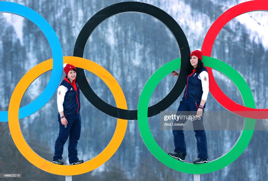 Rebekah Wilson and Paula Walker of the Great Britain Bobsleigh team pose for a portrait on the Olympic rings at the Athletes Village in the Rosa Khutor mountain village cluster prior to the Sochi 2014 Winter Olympics on February 3, 2014 in Sochi, Russia.