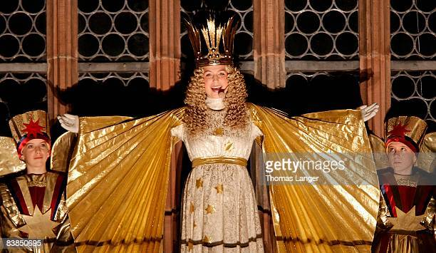 Rebekka Volland dressed as the 'Nuremberg Christ Child' appears in the window of the Frauenkirche during the opening ceremony of the Christmas Market...