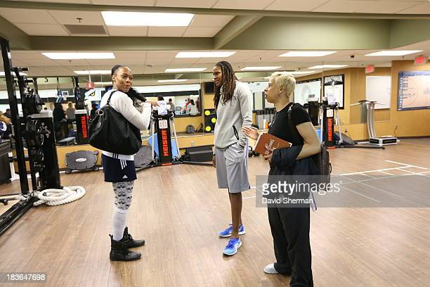 Rebekkah Brunson and Assistant Coach Shelley Patterson of the Minnesota Lynx and Le'Coe Willingham of the Atlanta Dream talk during media...