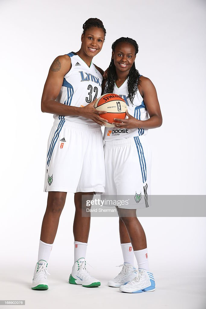 Rebekkah Brunson #32 and Ta'Shauna 'Sugar' Rodgers #15 of the Minnesota Lynx pose for portraits during 2013 Media Day on May 16, 2013 at the Minnesota Timberwolves and Lynx LifeTime Fitness Training Center at Target Center in Minneapolis, Minnesota.