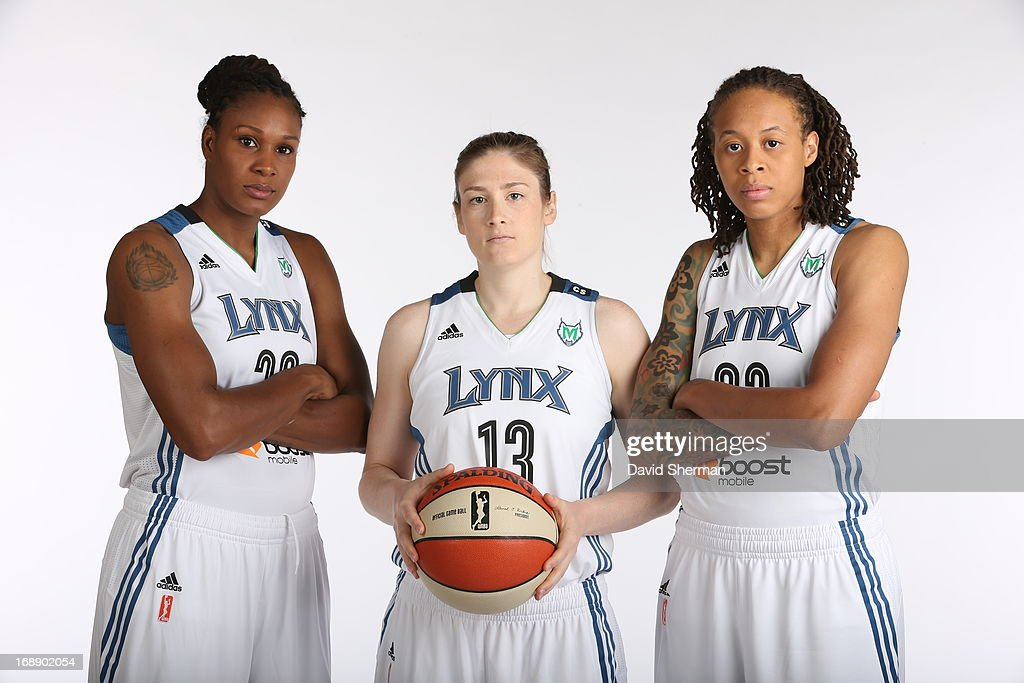 Rebekkah Brunson #32, Lindsay Whalen #13 and Seimone Augustus #33 of the Minnesota Lynx pose for portraits during 2013 Media Day on May 16, 2013 at the Minnesota Timberwolves and Lynx LifeTime Fitness Training Center at Target Center in Minneapolis, Minnesota.