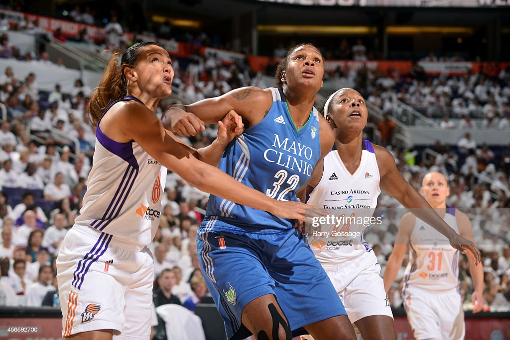 Rebekkah Brunson #32 of the Minnesota Lynx battles for position against Mistie Bass #8 and Eshaya Murphy #14 of the Phoenix Mercury in Game 1 of the 2014 WNBA Western Conference Finals on August 29, 2014 at US Airways Center in Phoenix, Arizona.