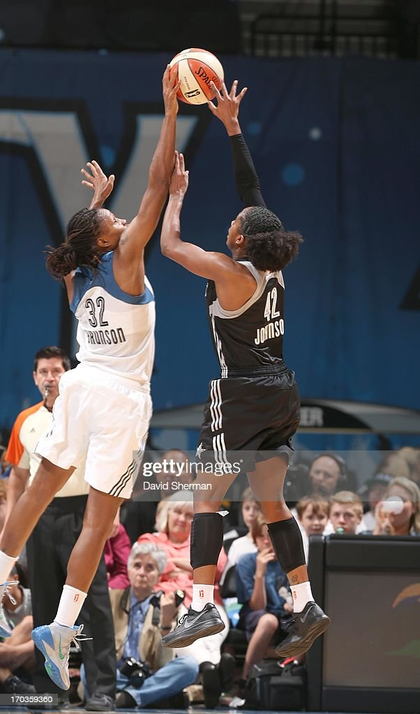Rebekkah Brunson #32 of the Minnesota Lynx blocks the basketball against Shenise Johnson #42 of the San Antonio Silver Stars during the WNBA game on June 11, 2013 at Target Center in Minneapolis, Minnesota.
