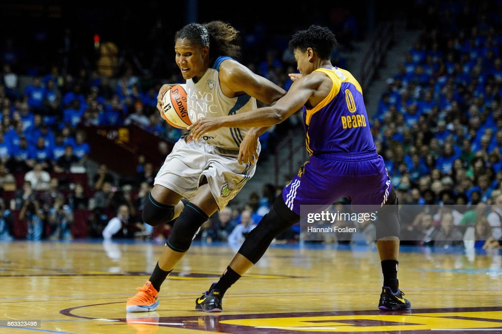 Rebekkah Brunson #32 of the Minnesota Lynx drives to the basket against Alana Beard #0 of the Los Angeles Sparks during the second quarter of Game Two of the WNBA Finals on September 26, 2017 at Williams in Minneapolis, Minnesota. The Lynx defeated the Sparks 70-68.