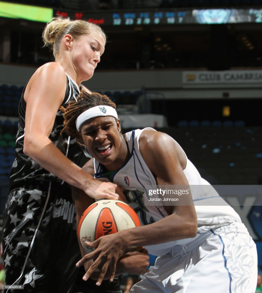 Rebekkah Brunson #32 of the Minnesota Lynx fights for possession against Jayne Appel #32 of the San Antonio Silver Stars during the game on July 22, 2010 at the Target Center in Minneapolis, Minnesota.