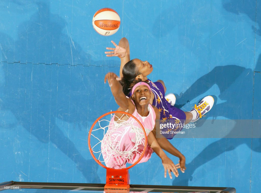 Rebekkah Brunson #32 of the Minnesota Lynx goes for the rebound against Tina Thompson #32 of the Los Angeles Sparks during the game on July 27, 2010 at the Target Center in Minneapolis, Minnesota.