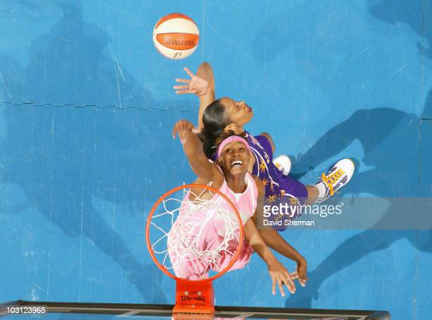 Rebekkah Brunson of the Minnesota Lynx goes for the rebound against Tina Thompson of the Los Angeles Sparks during the game on July 27 2010 at the...