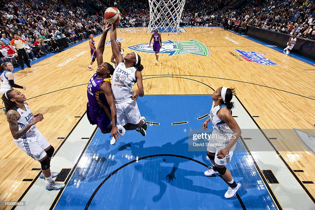 Rebekkah Brunson #32 of the Minnesota Lynx goes for the rebound against Nicky Anosike #55 of the Los Angeles Sparks during Game One of the 2012 WNBA Western Conference Finals on October 4, 2012 at Target Center in Minneapolis, Minnesota.
