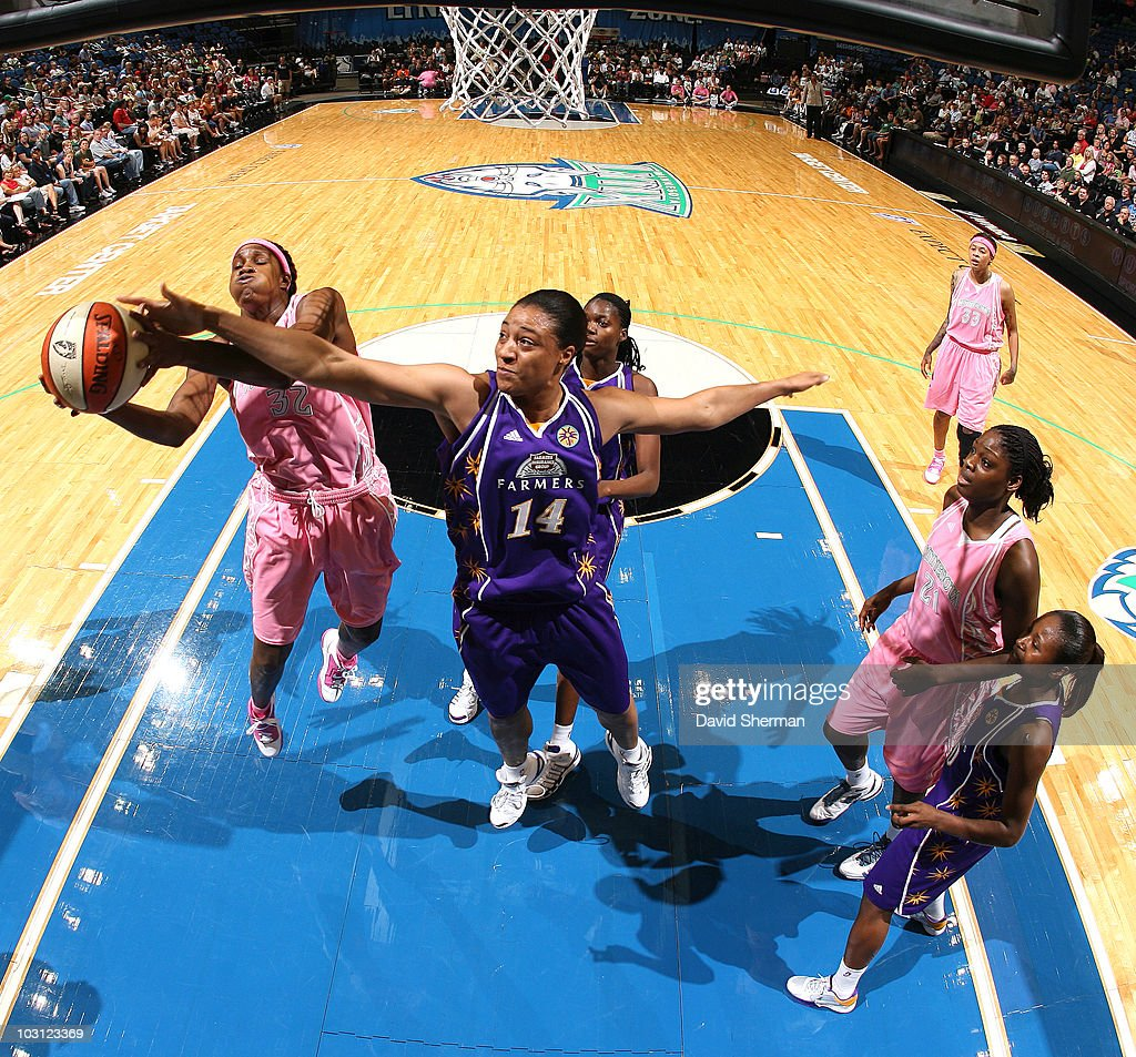 Rebekkah Brunson #32 of the Minnesota Lynx is fouled by Lindsay Wisdom-Hylton #14 of the Los Angeles Sparks during the game on July 27, 2010 at the Target Center in Minneapolis, Minnesota.