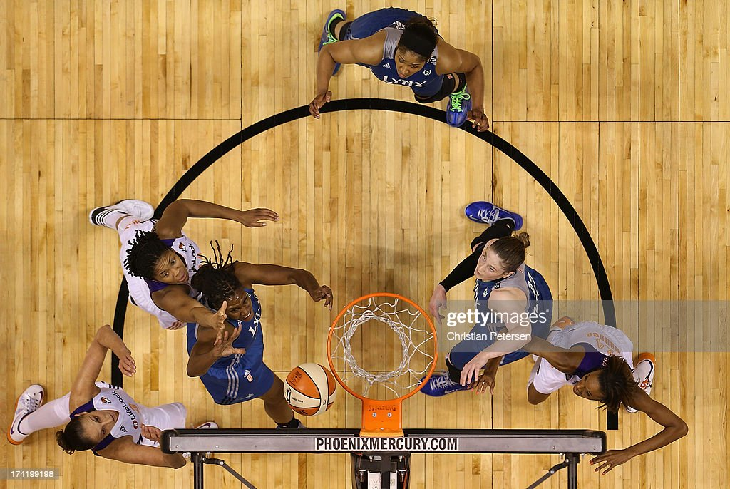 Rebekkah Brunson #32 of the Minnesota Lynx lays up a shot under pressure from Krystal Thomas #34 of the Phoenix Mercury during the first half of the WNBA game at US Airways Center on July 21, 2013 in Phoenix, Arizona. The Lynx defeated the Mercury 82-77.
