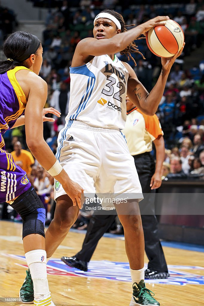 Rebekkah Brunson #32 of the Minnesota Lynx looks to pass against Candace Parker #3 of the Los Angeles Sparks during Game One of the 2012 WNBA Western Conference Finals on October 4, 2012 at Target Center in Minneapolis, Minnesota.