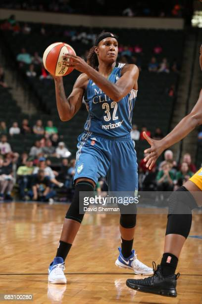 Rebekkah Brunson of the Minnesota Lynx looks to pass the ball during a game against the Chicago Sky on May 14 2017 at Xcel Energy Center in St Paul...
